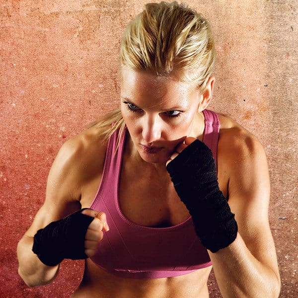 Mixed Martial Arts Lessons for Adults in _Citrus Heights_ _CA_ - Lady Kickboxing Focused Background