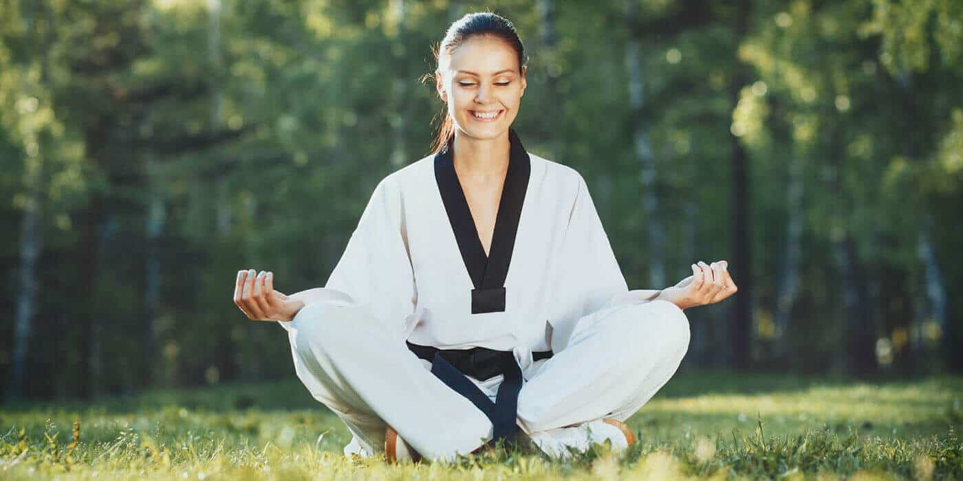 Martial Arts Lessons for Adults in _Citrus Heights_ _CA_ - Happy Woman Meditated Sitting Background